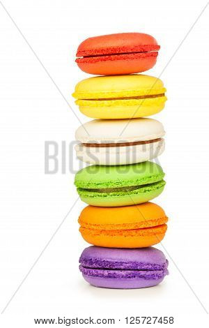 French colorful macarons standing on top of each other isolated on white background