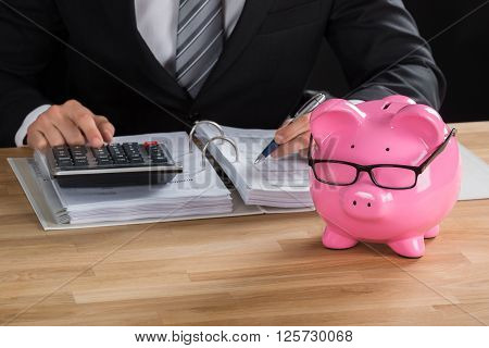 Male Accountant Calculating Tax At Desk