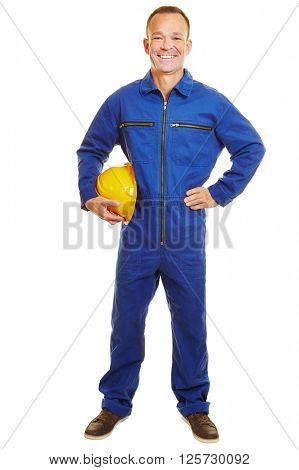 Happy isolated fully body construction worker with helmet in a jumpsuit