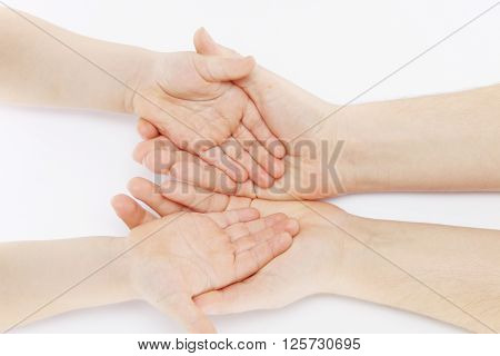 warm mother's hand hold children's gentle hands in his hands