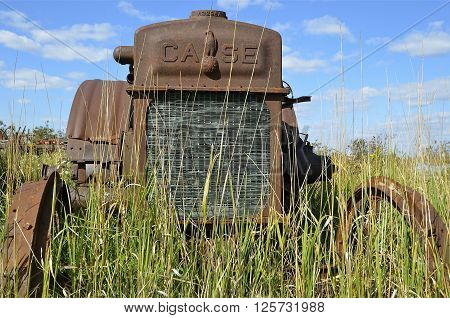 BARNESVILLE, MINNESOTA-September 14, 2014: A very old tractor is an early product from The Case Corporation, a manufacturer of construction equipment and agricultural equipment, founded by Jerome I. Case, it existed for over 150 years.