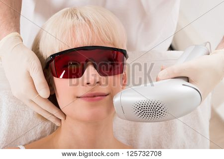 Close-up Of Woman Receiving Laser Epilation Treatment At Spa