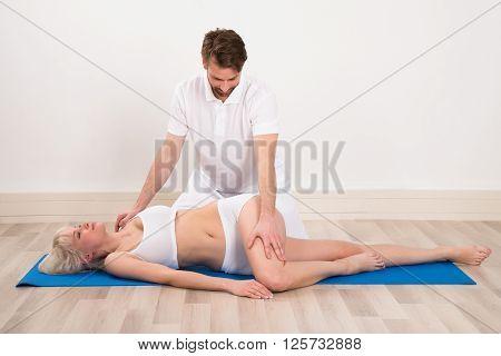 Woman Receiving Chiropractor Massage