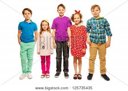 Five happy age-diverse kids, boys and girls, standing in row, isolated on white background