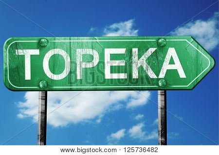 topeka road sign on a blue sky background