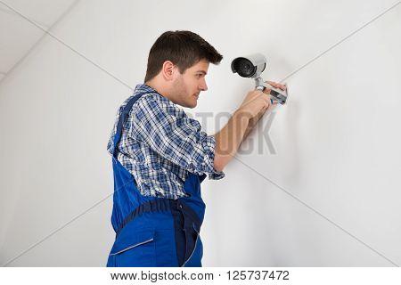 Technician Adjusting Cctv Camera