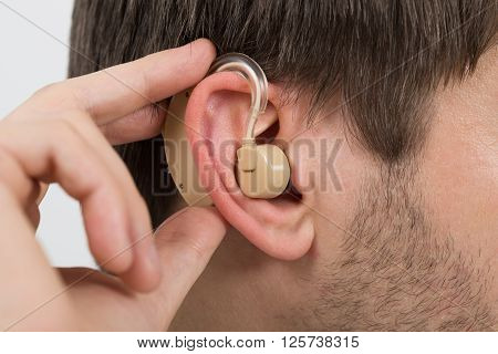 Man Wearing Hearing Aid In Ear
