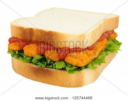 Breadcrumb coated fish finger sandwich with tomato sauce isolated on a white background