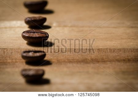 close up image of a row of coffee beans