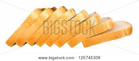 Thickly sliced white processed bread loaf isolated on a white background