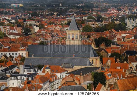 Wide angle panoramic view from above the top of Belfry to the roofs of ancient Europe medieval city Brugge