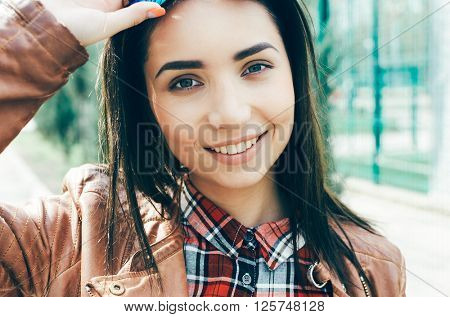 Summer lifestyle fashion portrait of young stylish hipster woman walking on street, smiling enjoy weekends