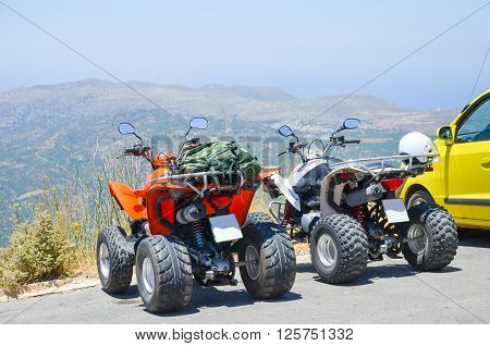 Two quad bikes in the parking lot in Greece