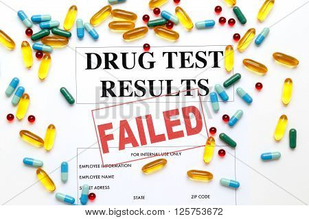 concept drug test results are failed with pills on white background