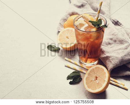 Refreshing ice tea drink with lemon