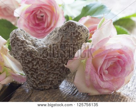 stone heart with roses