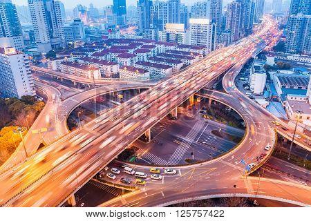 city interchange closeup at busy nightfall shanghai China