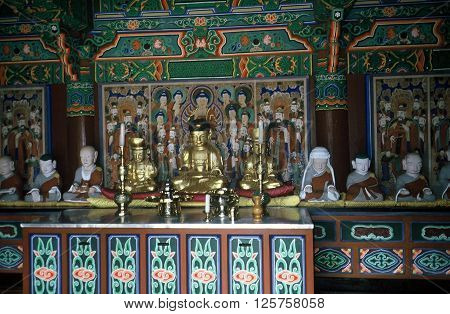 GYEONGJU CITY, NORTH GYEONGSANG PROVINCE / KOREA - CIRCA 1987: Images of the Buddha sit on an altar in the Bulguksa Buddhist Temple