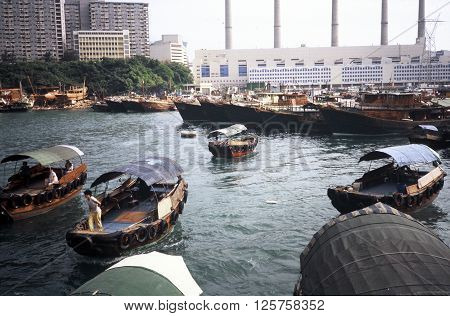 ABERDEEN / HONG KONG - CIRCA 1987: Wooden motorboats float in the harbor at the Aberdeen Floating Village in Hong Kong.