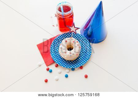 american independence day, celebration, patriotism and holidays concept - close up of glazed sweet donut decorated with star, juice in glass mason jar or mug and candies at 4th july party from top
