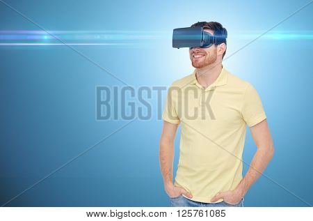 3d technology, virtual reality, entertainment and people concept - happy young man with virtual reality headset or 3d glasses over blue background and laser light