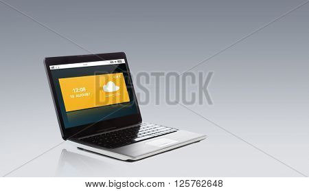 technology, forecast and meteorology concept - laptop computer with weather cast on screen