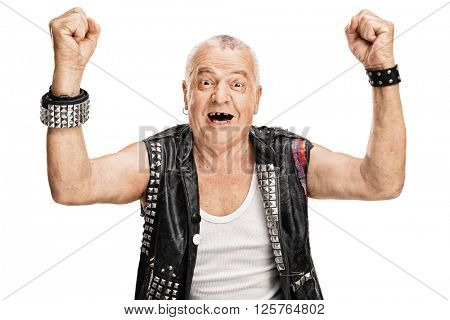 Studio shot of a delighted mature punk rocker gesturing happiness with his hands isolated on white background