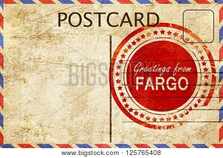 greetings from fargo, stamped on a postcard