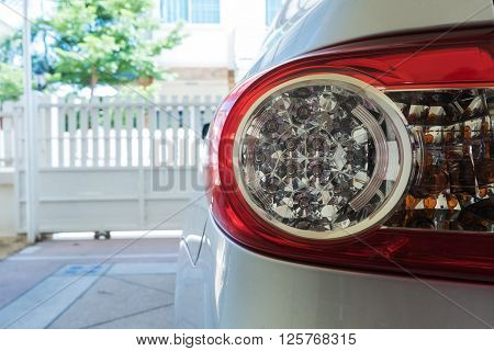 Car Parked In Garage, Close-up Part Of Tail Light Of Car
