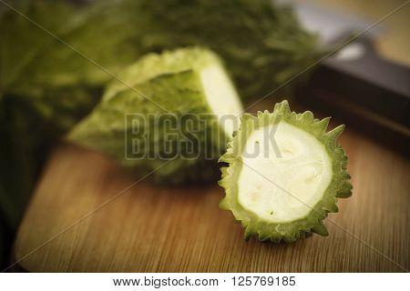 Sliced Green Momordica or karela on chopping board