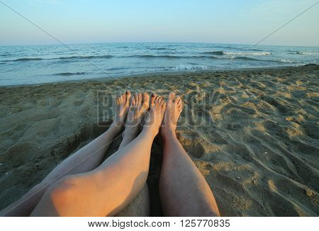 Four Bare Feet Of The Couple In Love