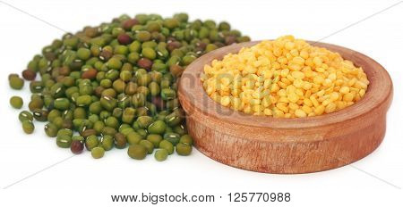 Mung bean in wooden bowl over white background