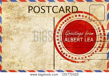 greetings from albert lea, stamped on a postcard