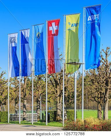 Zurich, Switzerland - 11 April, 2016: flags at the entrance of the FIFA headquarter. FIFA (International Federation of Association Football) is the governing body of association football.
