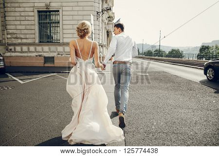 gorgeous wedding couple walking into their wedding day in Budapest