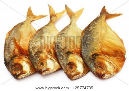 Dry scaled sardine fish over white background