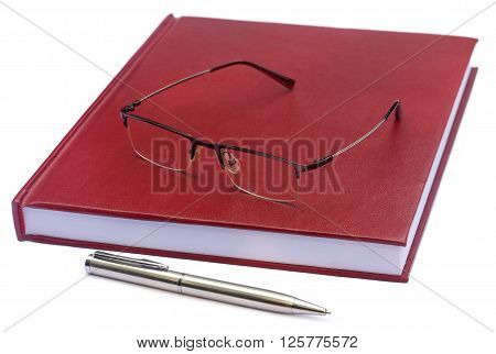 Maroon colored thesis paper with spectacles over white background
