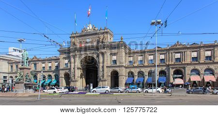 Zurich, Switzerland - 11 April, 2016: facade and entrance of the Zurich Main train station building view from Bahnhofplatz square. Zurich Main train station (German: Zurich Hauptbahnhof or Zurich HB) is the largest train station in Switzerland.