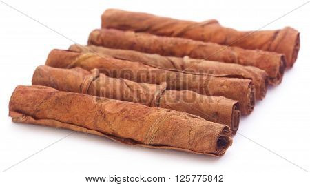 Close up of Rolled tobacco leaves over white background
