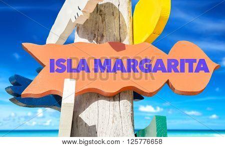 Isla Margarita signpost with beach background