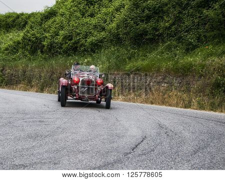 PESARO, ITALY - MAY 15: ALFA ROMEO 6C 1750 GS Spider Zagato 1930 on an old racing car in rally Mille Miglia 2015 the famous italian historical race (1927-1957) in May 2015