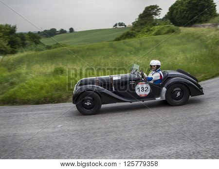 PESARO, ITALY - MAY 15:  BMW 328 1937 on an old racing car in rally Mille Miglia 2015 the famous italian historical race (1927-1957) on May 2015