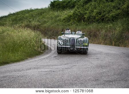 PESARO, ITALY - MAY 15: JAGUAR XK 120 OTS Sports 1950 on an old racing car in rally Mille Miglia 2015 the famous italian historical race (1927-1957) on May 2015