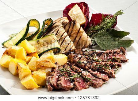 Steak Slices With Potato, Eggplant And Squash