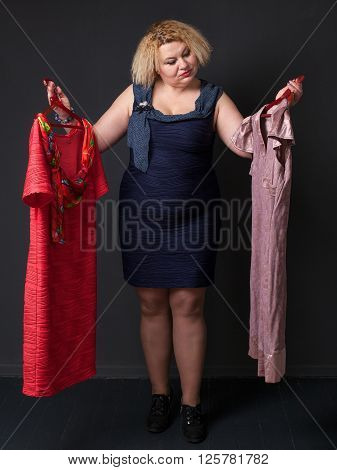 Mature Blonde Woman  Choosing Dress