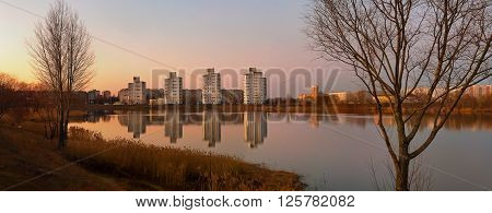 Beautiful view of evening Gomel with reflection in the lake. Volotova