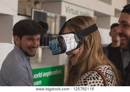Girl Wearing Virtual Reality Headset At Fuorisalone 2016 In Milan, Italy