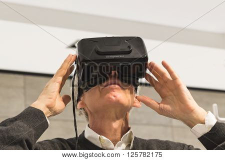 Man Wearing Virtual Reality Headset At Fuorisalone 2016 In Milan, Italy
