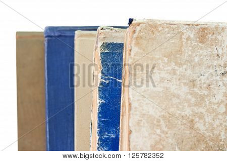 Stack of worn books isolated on white background