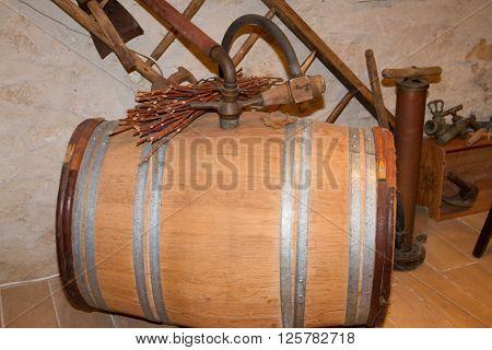 Close Up Of Wooden Wine Barrel In Wine Cellar